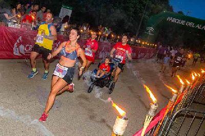 Foto promocional de la Carrera Nocturna del Parque del Alamillo de Sevilla